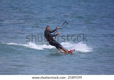 mans  hobbies and recreation - kitesurfing, Haifa beach, Israel