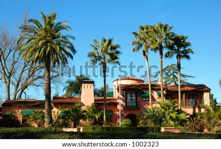 Mansion in California with palm trees