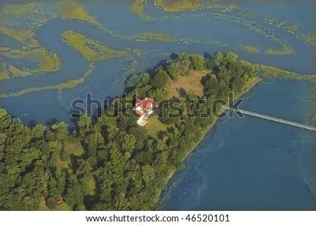 mansion on the water, aerial view