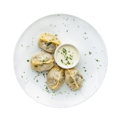 Manti in a plate on a white background.  Top view. Isolated
