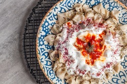 Manti Turkish Ravioli Kayseri with yogurt and chili sauce