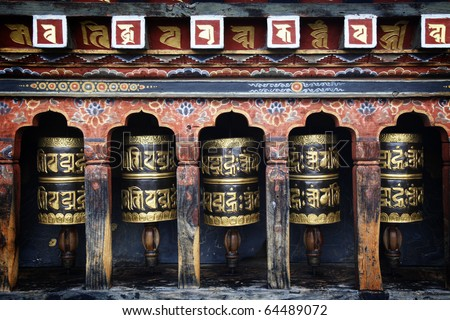 Mantra written on prayer wheels in Bhutan.