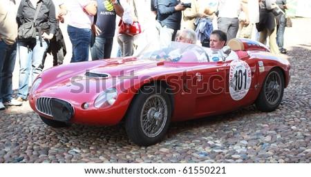MANTUA, ITALY - SEPTEMBER 19: A 1952 Fiat 1100 sport parades at a veteran cars event Gran Premio Nuvolari in honor of famous Italian car champion Tazio Nuvolari September 19, 2010 in Mantua, Italy.
