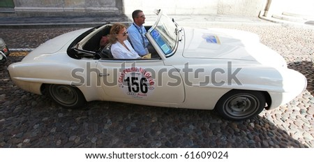 MANTUA, ITALY - SEPTEMBER 19: A 1956 Mercedes 190 SL parades at Gran Premio Nuvolari in honor of famous Italian car champion Tazio Nuvolari September 19, 2010 in Mantua, Italy. - stock photo