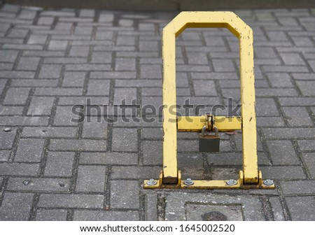 Manual car parking barrier with lock and stop sign. Car parking lock device. Dedicated parking for guests. Traffic rules, prohibitory signs Stockfoto ©