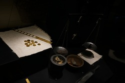 Manual coinage. coinage in the anvil. Work place. Scales with coin. gold bars and nuggets