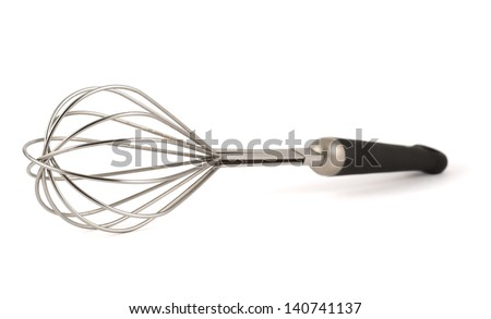Manual hand egg beater mixer isolated over white background, shallow DOF