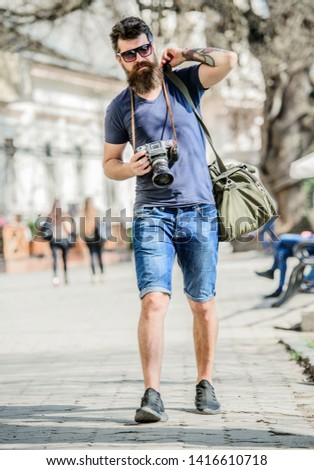 Manual settings. Photographer with beard and mustache. Tourist shooting photos. Content creator. Man bearded hipster photographer. Old but still good. Photographer hold vintage camera. Modern blogger.