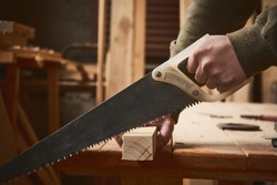 Manual wood worker carpenter with saw with safety tools