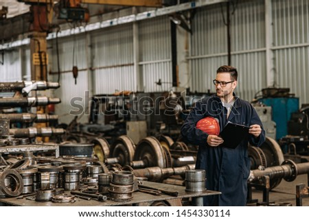 Manual worker at heavy industry workshop.