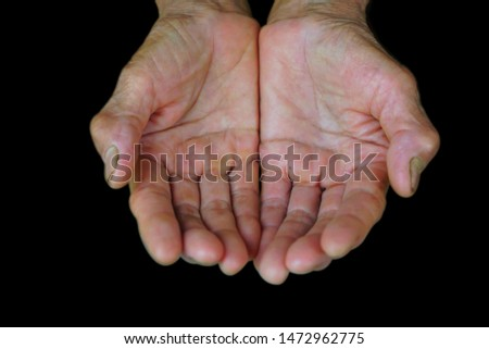 Manual worker hands senior with black Backgrounds