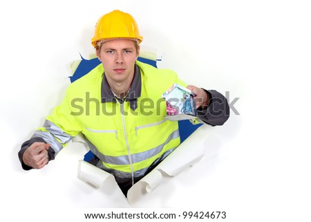 Manual worker holding cash - stock photo