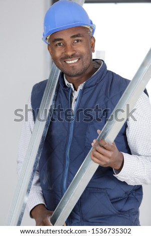 manual worker holding metal length