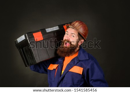 Manual worker. Man with tool box. Builder with box for instruments. Tools for repair. Repair kit. Builder with tool box. Repairman in overall hold toolbox. Builder in protective helmet with toolbox.