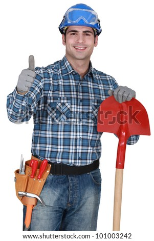 Manual worker with gloves and spade giving thumbs-up