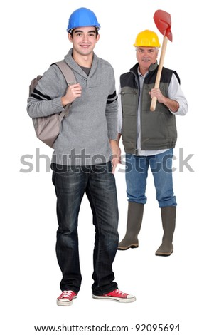 Manual worker with young apprentice