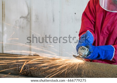 Manual worker work in factory with grinder