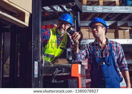 Manual Workers Working In Warehouse