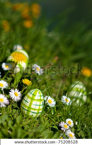 Manually decorated and painted easter eggs in spring glass with flowers