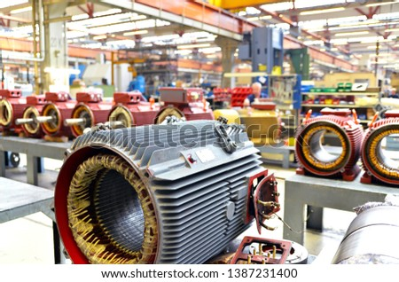 manufacture of big electronic motors in an industrial company - equipment and interior of the production halls  #1387231400