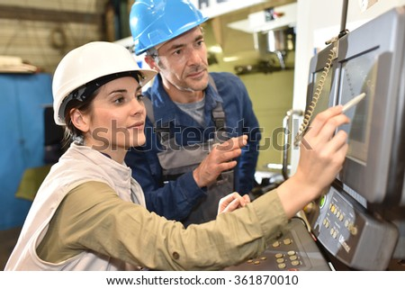 Manufacture workers working on electronic machine