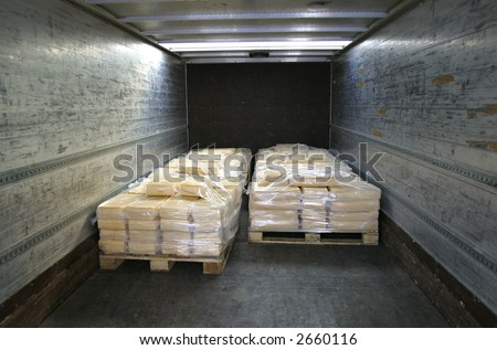 manufactured cheese on pallets in back of refridgerated truck