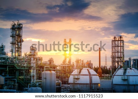 Manufacturing of oil and gas refinery industrial or Petrochemical industry plant on sunset sky background with smoke stacks and gas sphere tanks #1117915523