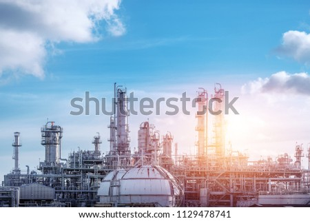 Manufacturing of petrochemical industrial or Oil and gas refinery plant with sunset sky stock photo