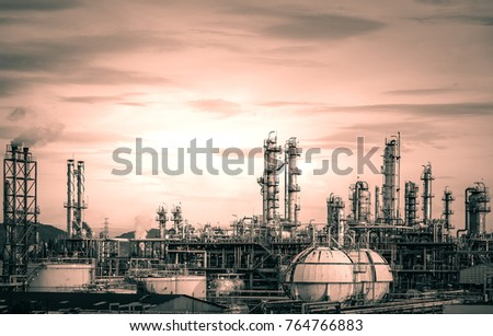 Manufacturing of petrochemical industry with sunset sky background, Oil and gas refinery plant, Old factories with distillation tower, Climate change concept #764766883
