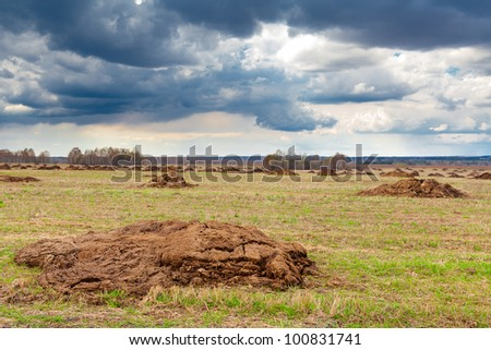Manure in the field against clouds