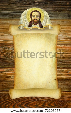 Manuscript for a prayer or an old form to the sacred text in the old Russian style with a Christian image of Jesus Christ. Vintage background on the brown wooden texture. Dark old parchment blank.