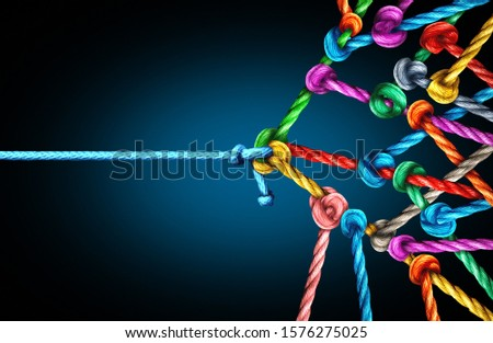 Many against one business concept as one underdog single rope pulling in a tug of war with a large group of ropes tied together as a power and leader metaphor.