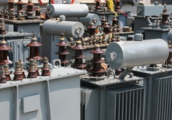 many alienated old electrical transformers in the storage before proper disposal to not pollute