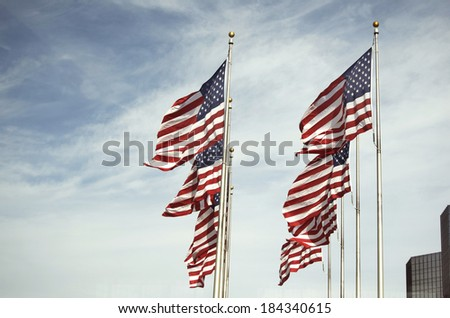 Many American Flags Waving On Poles In Detroit
