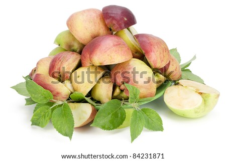 Many apples are cut by slices and prepared for processing - of expression of apple juice