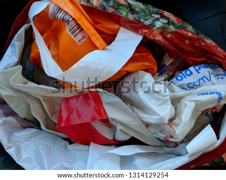 Many 'Bags For Life' stuffed into a single bag so that they can be reused, following the ban on free, disposable, single use plastic carrier bags and charge for reusable bags in UK supermarkets Stok fotoğraf ©