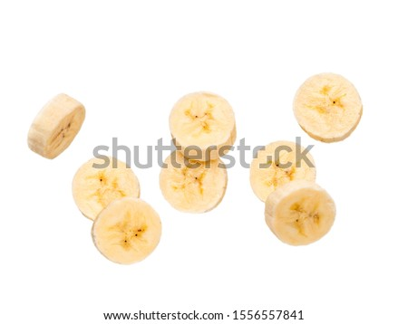 Many banana slices falling, isolated on white background with clipping path. Studio shoot.
