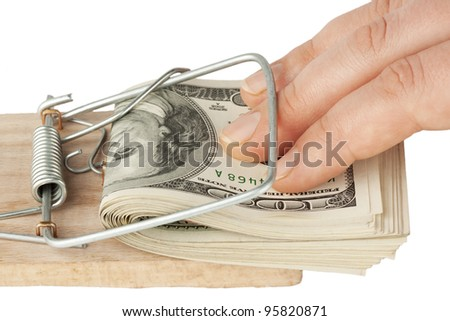 Many banknotes in mouse trap on the white background