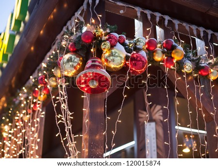 many beautiful Christmas decorations adorn the facade of the building