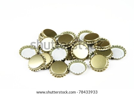Many beer bottle caps on white background.