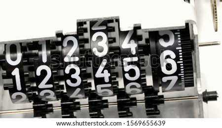 many big plastic numbers of an alalogic counter