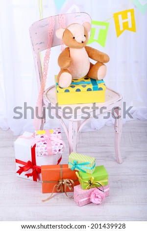 Many birthday gifts in room