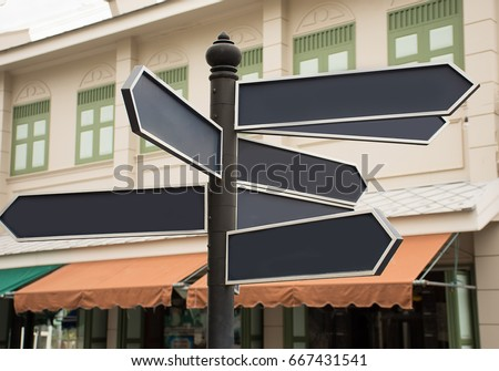 Many blank direction road sign on vintage building background  #667431541