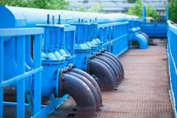 Many blue gas pipelines with stop-gate valves at industrial plant