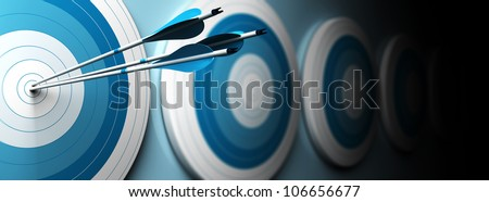 many blue targets and three arrows hitting the center of the first one, horizontal image, banner style