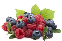 Many blueberries & raspberries. Isolated white