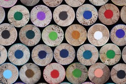 Many blunt multicolored wooden pencils closeup background