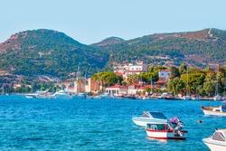 Many boats in the marina with coastline of resort town of Foca - Izmir, Turkey