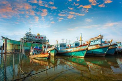 Many boats moored in sunrise morning time at Chalong port, Main port for travel ship to krabi and phi phi island, Phuket, Thailand