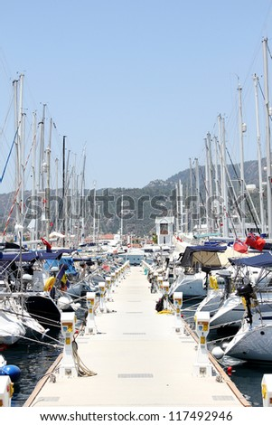 Many boats moored in the harbor. Marina in the Mediterranean